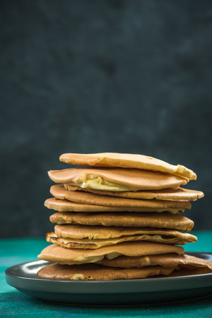 Pile of homemade pancakes on plate. Copy space. Stok Fotoğraf - 93148822