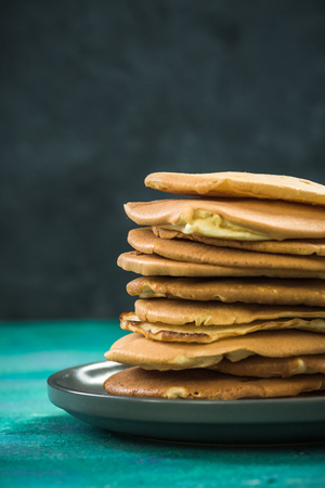 Pile of homemade pancakes on plate. Copy space. Banco de Imagens