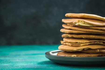 Homemade pancakes stack in pile on plate, copy space 스톡 콘텐츠
