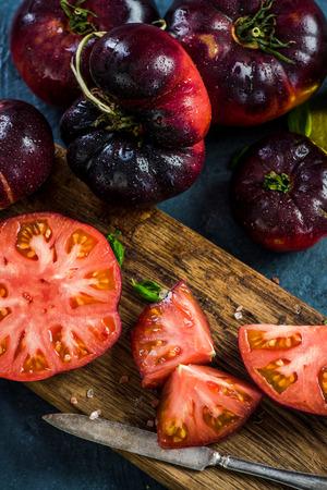 Ingredients for making fresh healthy tomatoes salad. Stock fotó