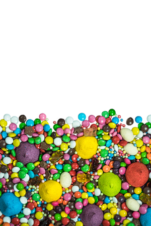 Vibrant sweets frame background isolated on white.