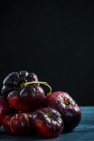 Dark ripe fresh Crimea tomatoes. Stock fotó