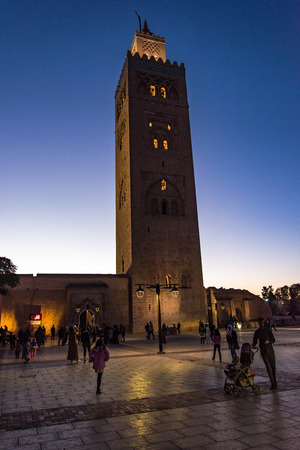 Marrakech,Morocco - January 24th 2018: Tourists and locals walking in the evening by Koutoubia Mosque.