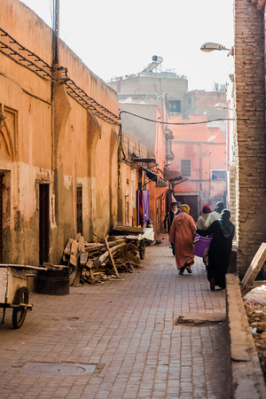 Marrakech,Morocco - January 2018:Daily life in dirty and ruined back street of Marrakesh