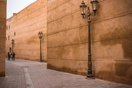 Marrakech,Morocco - January 2018:Carved lanterns and old wall in back street of Morocco Editorial