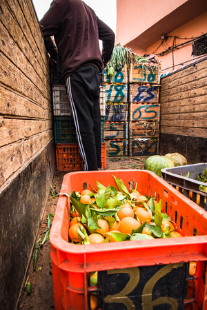 Man selling fresh fruits from truck in North Africa food market Stock Photo