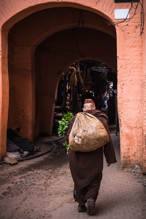 Old man walking in traditional clothing in Morocco.. Stock Photo