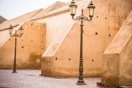 street lamp posts and old town wall in Morocco.