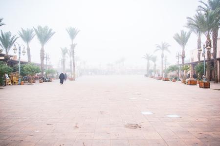 Marrakesh plazza in foggy day.