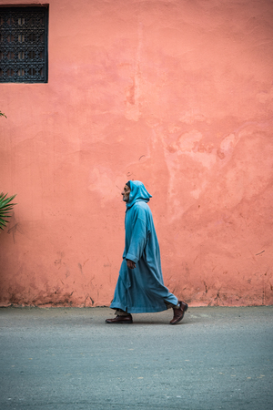 Marrakech,Morocco - January 2018: Man in Berber traditional clothing walking on street in Marrakesh Editorial