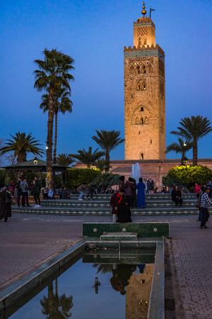 Marrakech,Morocco - January 24th 2018: Moroccans enjoy warm evening in Koutoubia Mosque Gardens,Marrakesh.