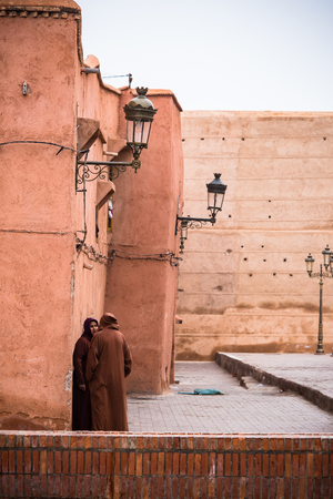 Marrakech,Morocco - January 2018:People in traditional muslim clothes talking on stret in Morocco.