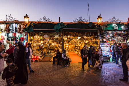 Marrakech,Morocco - January 2018:LOcal shop with lamps illuminated at evening in Jemma el Fna market.