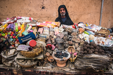 Marrakech,Morocco - January 2018:Old man selling incense on street stall in Marrakesh.