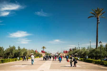 Marrakech,Morocco - January 2018: Local people enjoying winter sun in Menara Gardens,marrakesh,Morocco.