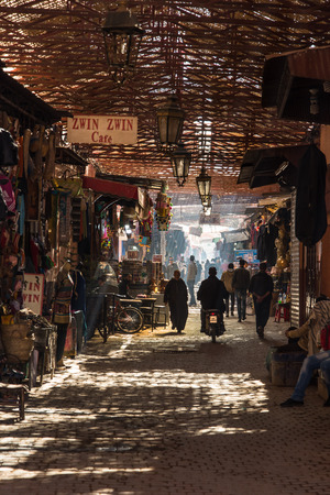 Marrakech,Morocco - January 2018:Locals and tourist walking in narrow street in Marrakesh Editorial
