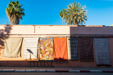 Carpets for sale on the wall in Morocco. Imagens