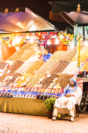 Marrakech,Morocco - January 2018: Fruit and spices seller in Morocco Jema El Fna market square.