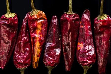 Dried red peppers macro shoot on dark.