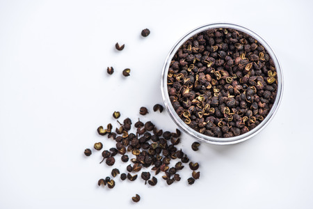 Tumit Nepalese pepper in pot on bright background