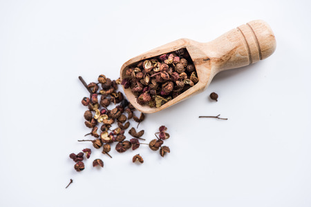 Wooden spoon with Chinese coriander,Sichuan pepper. Stock Photo