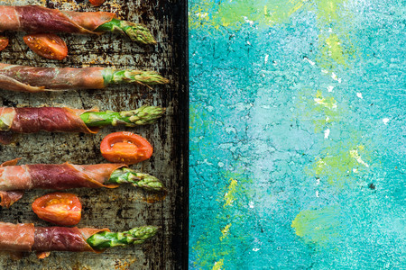 Farm fresh asparagus wrapped in prosciutto ham.