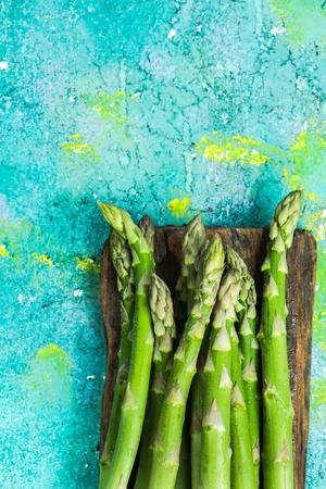 Seasonal asparagus on wooden board.