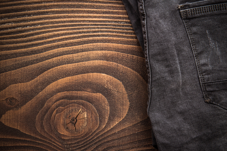 Black jeans trousers border background.