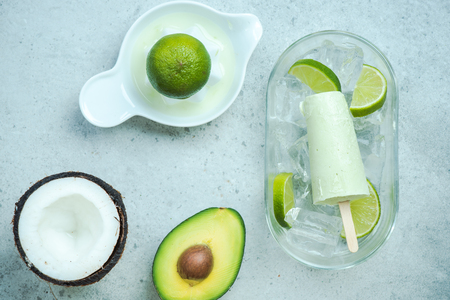 Avocado,lime and coconut healthy trendy ice lolly Stock Photo - 96936519