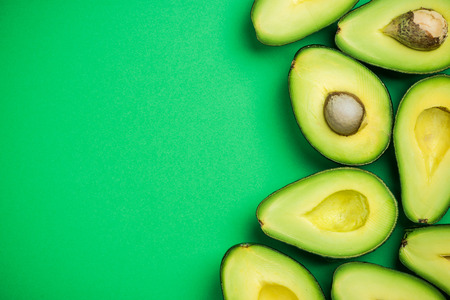 Avocado on pastel background,creative food concept.