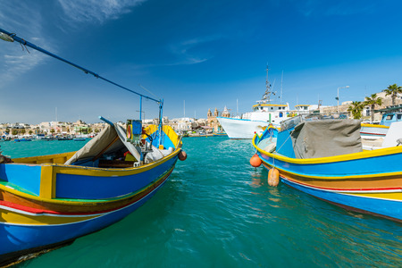 Beautiful colorful fishing boats in Marsaxlokk harbour,Malta. 免版税图像