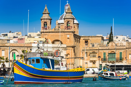 Coloful boats in Marsaxlokk port in Malta. 写真素材