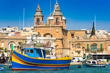 Coloful boats in Marsaxlokk port in Malta. Stok Fotoğraf