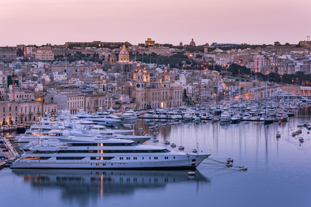 Birgu at evening and luxury yachts in harbor,Malta.