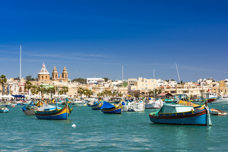 Colorful painted fishing boats in Marsaxlokk,Malta. Standard-Bild - 116910820