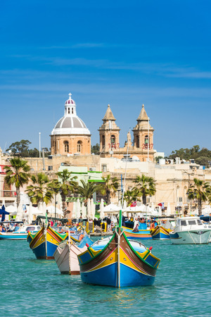Traditional fisherman village and boats,Malta. Stock Photo