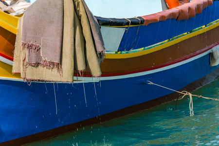 Traditional painted fisherman boat in Marsaxlokk village,Malta.