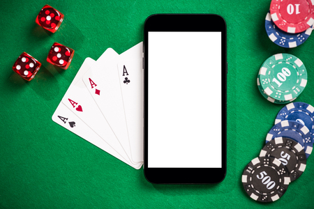 Online casino and poker games on mobile phone mock  up Stock Photo
