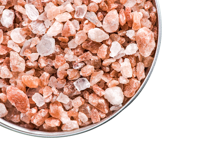 Himalayan salt cristals seeds in pot isolated on white.
