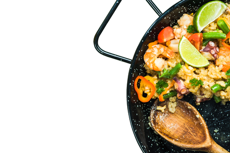 Traditional spanish paella isolated on whte, top view.