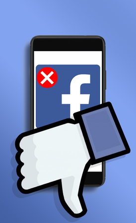 Warsaw,Poland- March 2018: illustrative concept, user deleting Facebook acount due to Cambridge Analytica data leaks. Редакционное