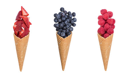 Ice cream cones with fresh fruits, isolated on white. 版權商用圖片