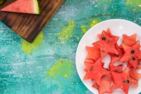 Star shapes cut off from fresh watermelon. Kids garden party food concept.