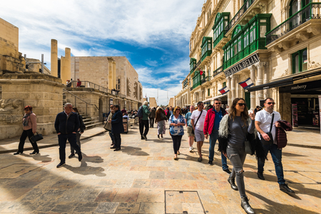 VALLETTA, MALTA - MARCH , 2018: Shoppers and tourist walking on European Culture Capital Valletta in Malta