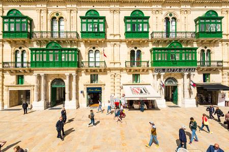 VALLETTA, MALTA - MARCH , 2018: Tuorist enjoying shopping in Valletta,Malta at hot sunny day.