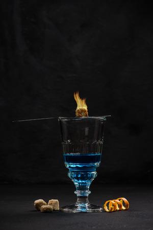 Bohemian style drinking Absinthe vodka. Stock Photo