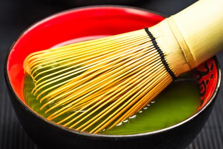 Traditional bamboo whisk and matcha tea.