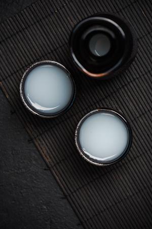 Sake in ceramic bowls, top view.