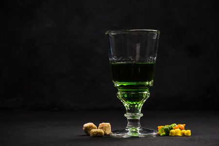 Green Absinthe in crystal glass.
