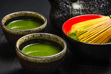 Green match atea in ceramic pots. Reklamní fotografie